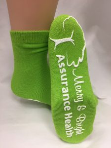 Assurance Health. Lime Green with white
